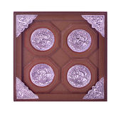 Coaster for beverages patterned on silver plate isolated on a wh Royalty Free Stock Photos
