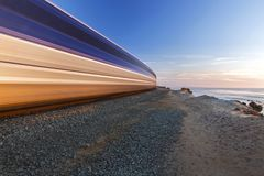 Coaster Commuter Train High Speed Del Mar Coast San Diego County. Coaster Commuter Train passing in High Speed through Del Mar Heights in San Diego County royalty free stock photo
