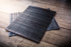 The Coaster, Dark brown bamboo mat Stock Image