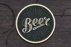 Coaster with hand drawn lettering Beer Stock Photography