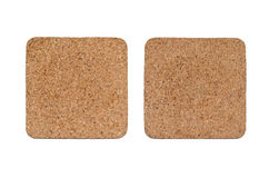 Coasters made of cork on white underground Royalty Free Stock Photo