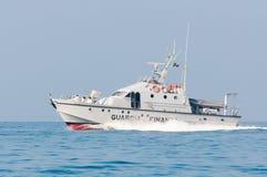 Coastguard boat patrolling in Mediterranean sea. Anzio, Italy - August 12, 2010: a coastguard ship patrolling the sea in italy Stock Images