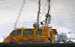 Coastguard boat reflected in water. Moored in marina royalty free stock photo