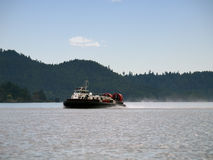 Coastguard Hovercraft. Flying across the ocean in southern British Columbia Royalty Free Stock Photos