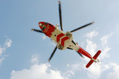 Coastguard Rescue Helicopter. British Coastguard rescue helicopter hovering above __ motion blur on rotor blades Stock Photography