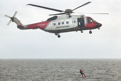 Coastguard rescue helicopter team in action. Scotland. UK Stock Image
