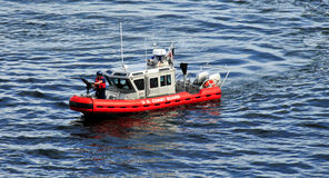 Coastguard vesel or ship. Coastguard vessel or ship in blue sea royalty free stock images