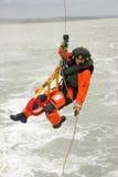 Coastguard Winchman royaltyfri bild