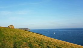 Coastguards watch post near Porthlune cove in the distance . Southwest coastal path . South Cornwall Royalty Free Stock Photos