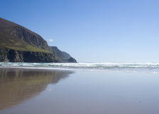 Coastline. A beautiful clean beach underneath come cliffs stock photos