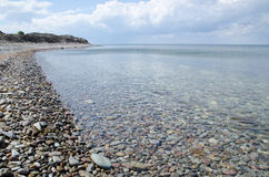 Coastline. With pebbles and clear blue water in scandinavia Royalty Free Stock Photo