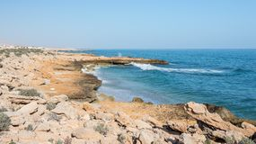 Coastline. With rocks surrounding patches of sand Royalty Free Stock Photography