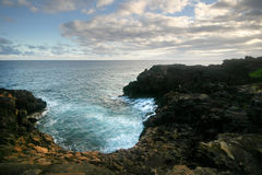 Coastline. Waves crashing against the rocky coastline of Hawaii Stock Photos