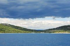 Coastline of Adriatic Sea under dark blue clouds Stock Image