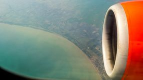 Coast line from airplane window stock photography