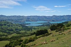 Coastline of Akaroa, New Zealand. Akaroa is a very pretty town on the banks peninsular, near Christchurch on New Zealand's South Island Royalty Free Stock Image
