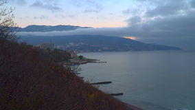 The coastline on the background of mountains and clouds stock video