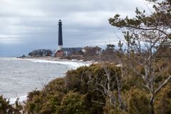 Coastline of Baltic sea with Sorve lighthouse on cape at spring season. The Saaremaa island, Estonia, Europe. Coastline of Baltic sea with Sorve lighthouse on Royalty Free Stock Photography