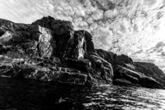 Coastline of Barents sea in northern polar summer. Black and white image. Arctic ocean, Kola Peninsula, Russia royalty free stock photo