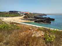 Coastline with beach and buildings near Cabo Carvoeiro in daylight, Peniche Stock Photography