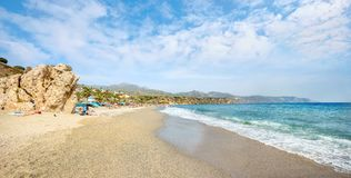 Coastline and beach in Nerja. Malaga province, Costa del Sol, An. Panoramic view of beach in Nerja town. Malaga province, Costa del Sol, Andalusia, Spain Stock Photography