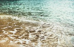 Coastline beach on sunny day background of ocean and sky, gold sand close up blur, tourism relax calm concept, seascape. Perspective vacation, summer seashore royalty free stock photos
