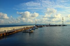 Coastline and boats standing at the pier in the evening Royalty Free Stock Photo