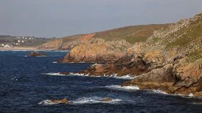 Coastline in Britany. Waves crushing the rocks on Brittany coast near the Point du Raz stock video