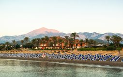 Coastline with chaise-longues at resort in Kemer on sunrise stock image