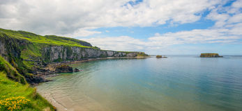 Coastline and cliff at carrick a rede in Northern Ireland. With blu sky royalty free stock image