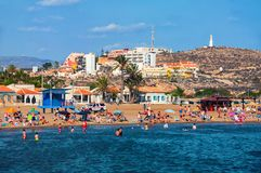 Coastline of Costa Calida in Murcia region. MAZARRON, SPAIN - JUNE 15, 2014: Coastline of Costa Calida in Murcia region. People at the small secure beach with Royalty Free Stock Photos