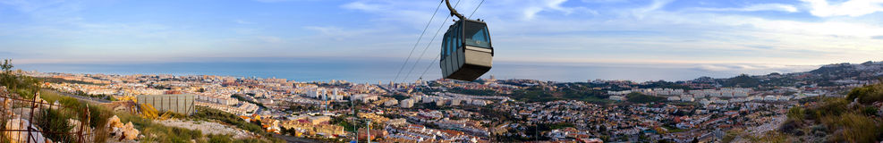 Coastline of Costa del Sol with Cable Car. Panoramic view of the Costa del Sol from Mijas to Torremolinos in Malaga. Very high resolution file. Cable car rising Royalty Free Stock Image