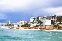 Coastline Costa Dorada, Salou, Spain. Beautiful sea and palms. On a beach Royalty Free Stock Photo