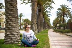 Pretty woman relax on coastline Costa Dorada, Salou, Spain. Beautiful sea and palms royalty free stock image
