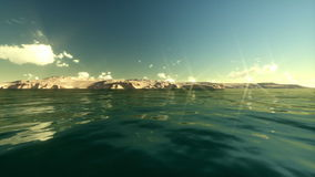 Coastline and couple on the beach, time lapse. Underwater to surface stock video footage