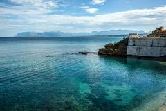 Coastline with crystal clear blue waters under blue skies and wh royalty free stock photos