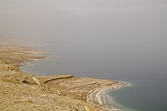 Coastline of Dead Sea - salt on coast and in water,View from abo. Ve.Salt crystals natural mineral formation may be different forms .Dead Sea has a salinity Royalty Free Stock Image