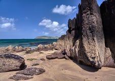 Coastline in Dingle, Ireland. Rocks at Wine Strand, Dingle, Ireland. The blue sea is cristal clear stock image