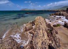 Coastline in Dingle, Ireland. Rocks at Wine Strand, Dingle, Ireland. The blue sea is cristal clear royalty free stock photo