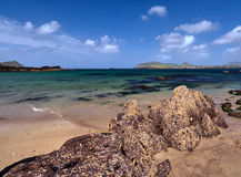 Coastline in Dingle, Ireland. Rocks at Wine Strand, Dingle, Ireland. The blue sea is cristal clear Stock Photo