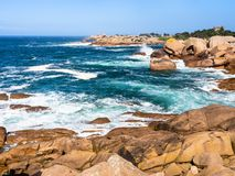Coastline of English Channel in Ploumanac'h site. Travel to France - rocky coastline of English Channel in Ploumanac'h site of Perros-Guirec commune on Pink Royalty Free Stock Photo