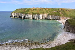 Coastline at Flamborough, east Yorkshire. View looking at some of the caves and the clear water at Thornwick Bay royalty free stock images