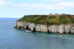 Coastline at Flamborough, east Yorkshire. View looking at some of the caves and the clear water at Thornwick Bay stock images