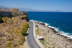 Coastline. Greece. Serpentine road along the costline and fortress, Rethymno, Crete, Greece stock image