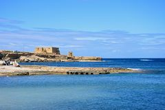 Coastline and gun battery, Marsalforn. View along the rugged coastline towards the Il-Qolla I-Badja battery, Redoubt, Marsalforn, Gozo, Malta, Europe Royalty Free Stock Images