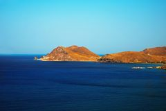 Coastline, hill and cliff in blue sea. Island Limnos, Greece. Stock Photography