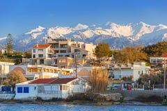 Coastline of Kato Galatas town on Crete. Coastline of Kato Galatas town with Samaria mountains on Crete, Greece Stock Photo