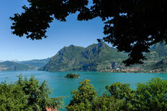 Coastline of Lake Iseo in Brescia, Italy. Coastline along Lake Iseo in Brescia, Italy in daylight Royalty Free Stock Photo