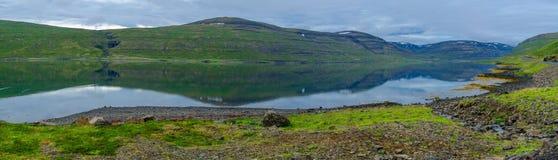 Coastline and landscape along the Isafjordur fjord. Panoramic view of coastline and landscape along the Isafjordur fjord, in the west fjords region, Iceland Royalty Free Stock Image