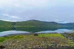 Coastline and landscape along the Isafjordur fjord. View of coastline and landscape along the Isafjordur fjord, in the west fjords region, Iceland Royalty Free Stock Image
